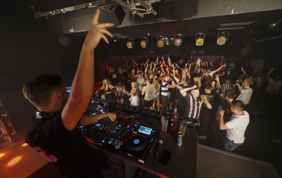 Clubbers take to the dance floor just minutes after Pryzm nightclub threw open its doors to celebrate the relaxing of Covid-19 rules in the early hours of July 19 in Brighton. (Getty)