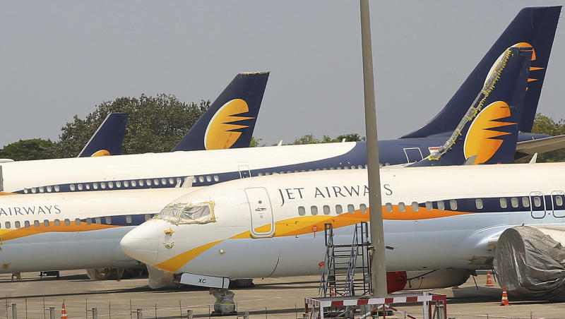 FILE - In this April 15, 2019, file photo, Jet Airways aircrafts are seen parked at Chhatrapati Shivaji Maharaj International Airport in Mumbai. India's Jet Airways said Wednesday, April 17, that it is suspending all operations after failing to raise enough money to run its services. (AP Photo/Rafiq Maqbool, File)
