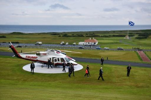 Donald Trump (2ndR) arrives to officially open his Trump Turnberry hotel and golf resort on June 24, 2016