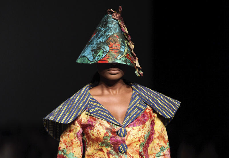 A model displays a creation by designer Weizdhurm Franklyn, during the MTN Fashion and Design Week in Lagos, Nigeria, Saturday, Oct. 27, 2012. (AP Photo/Sunday Alamba)