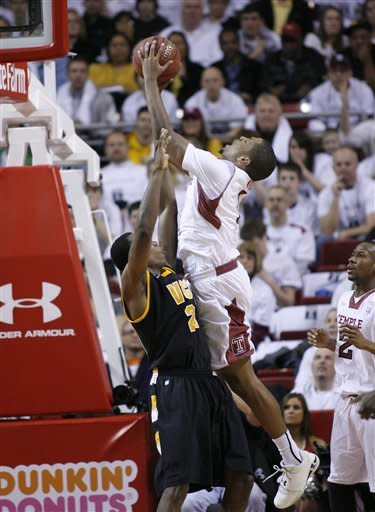 VCU's Treveon Graham, left, attempts to defend as Temple's Khalif Wyatt shoots in the second half of an NCAA college basketball game on Sunday, March 10, 2013, in Philadelphia. Temple won 84-76. (AP Photo/H. Rumph Jr)