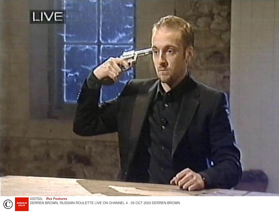 Brown performs a Russian Roulette stunt on live television in 2003Rex