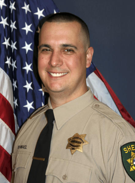 This undated photo provided by the El Dorado County Sheriff's Office shows Deputy Brian Ishmael. The Sheriff's office says Ishmael was fatally shot early Wednesday, Oct. 23, 2019 in the Sierra Nevada Foothills community of Somerset, Calif., and a ride-along passenger with him was injured. An office statement says two men were taken into custody but the scene about 45 miles east of Sacramento remains active. (El Dorado County Sheriff's Office via AP)