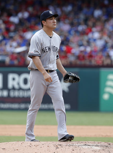 New York Yankees' Masahiro Tanaka walks back onto the mound as he works against the Texas Rangers in the third inning of a baseball game in Arlington, Texas, Sunday, Sept. 29, 2019. (AP Photo/Tony Gutierrez)