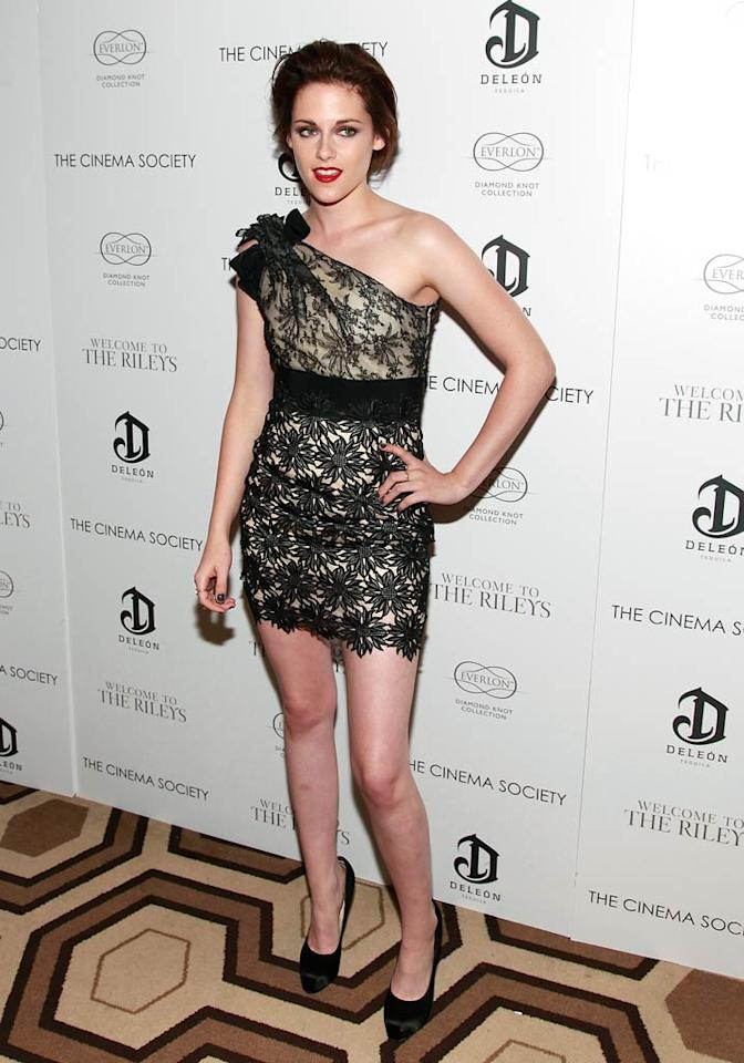 """Call us crazy, but we think Kristen Stewart has finally figured out how and what to wear to red carpet events. The """"Twilight"""" star looked truly sophisticated at the Cinema Society's screening of """"Welcome to the Rileys"""" thanks to her one-shoulder Valentino lace looker and Brian Atwood pumps. Charles Eshelman/<a href=""""http://www.filmmagic.com/"""" target=""""new"""">FilmMagic.com</a> - October 18, 2010"""