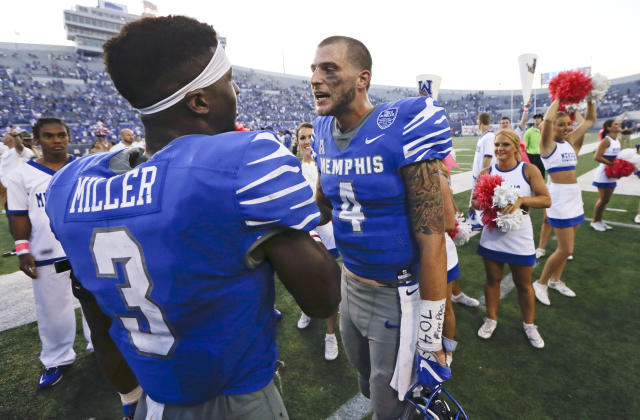 "Memphis quarterback <a class=""link rapid-noclick-resp"" href=""/ncaaf/players/227452/"" data-ylk=""slk:Riley Ferguson"">Riley Ferguson</a> (4) and wide receiver <a class=""link rapid-noclick-resp"" href=""/ncaaf/players/230330/"" data-ylk=""slk:Anthony Miller"">Anthony Miller</a> (3) have put up huge numbers this season. (AP Photo/Mark Humphrey, File)"