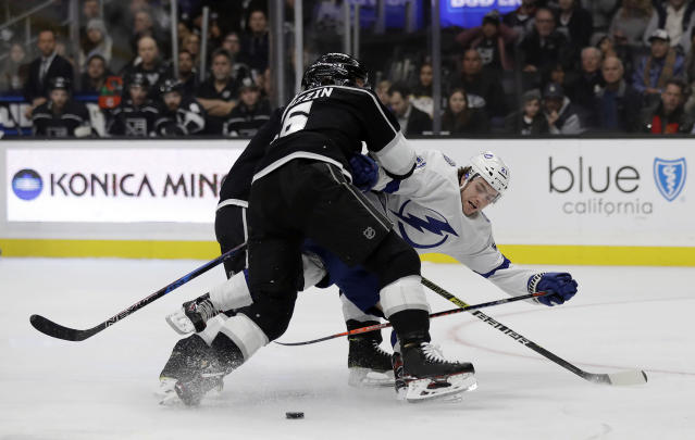 Tampa Bay Lightning's Brayden Point, right, collides with Los Angeles Kings' Jake Muzzin during the first period of an NHL hockey game Thursday, Jan. 3, 2019, in Los Angeles. (AP Photo/Marcio Jose Sanchez)