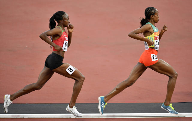 FILE - In this Sunday, Aug. 13, 2017 file photo, Ethiopia's Almaz Ayana leads Kenya's Hellen Onsando Obiri during the Women's 5000 meters final at the World Athletics Championships in London. The IAAFs decision to drop the 5,000 meters from its Diamond League track and field series has been met with strong resistance from Ethiopia and Kenya, the East African nations whose athletes dominate long-distance events. (AP Photo/Martin Meissner, File)