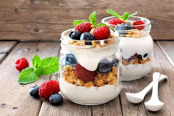 """<p>Low-fat dairy products are a great source of <a href=""""https://www.prevention.com/food-nutrition/healthy-eating/g20499990/calcium-rich-foods/"""" rel=""""nofollow noopener"""" target=""""_blank"""" data-ylk=""""slk:calcium"""" class=""""link rapid-noclick-resp"""">calcium</a>, which is one of the main compounds that help fight high blood pressure. A 12-ounce serving of low-fat yogurt will give you about 30 percent of the recommended amount of calcium for the day. </p><p><strong>Try it: </strong>For a burst of morning energy, mix a cup of low-fat Greek yogurt with granola, almond slivers and <a href=""""https://www.prevention.com/food-nutrition/healthy-eating/a26537540/health-benefits-of-strawberries/"""" rel=""""nofollow noopener"""" target=""""_blank"""" data-ylk=""""slk:berries"""" class=""""link rapid-noclick-resp"""">berries</a> for an extra heart-healthy boost. Check out these <a href=""""https://www.prevention.com/food-nutrition/healthy-eating/g20488250/25-things-you-can-do-with-yogurt/"""" rel=""""nofollow noopener"""" target=""""_blank"""" data-ylk=""""slk:25 things you can do with yogurt"""" class=""""link rapid-noclick-resp"""">25 things you can do with yogurt</a>.</p>"""