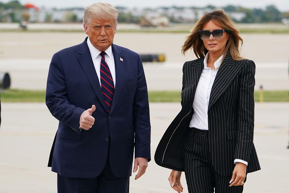 US President Donald Trump and First Lady Melania Trump step off Air Force One upon arrival at Cleveland Hopkins International Airport in Cleveland, Ohio on September 29, 2020. - President Trump announced early on October 2, 2020, that he and First Lady Melania Trump would be going into quarantine after they were both found to have contracted the novel coronavirus.
