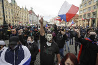 Demonstrators gather to protest the COVID-19 preventative measures downtown Prague, Czech Republic, Wednesday, Oct. 28, 2020. Coronavirus infections in the Czech Republic have again jumped to record levels amid new restrictive measures imposed by the government to curb the spread. (AP Photo/Petr David Josek)