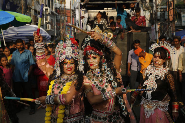 <p>Indian girls dressed as Hindu god Krishna and his consort Radha, dance in a procession as part of celebrations on the eve of Janmashtami festival in Allahabad, India, Sunday, September 2, 2018. The festival celebrates the birth of Hindu god Krishna. (AP Photo/Rajesh Kumar Singh) </p>