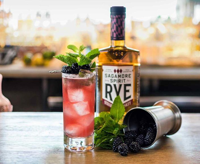 <p>Blackberry simple syrup infuses a darker, stronger spirit with fresh flavor (and a pretty red color!) that's just right for July. </p><p><strong><em>Ingredients</em><br></strong>1.5-ounce Sagamore Spirit Rye Whiskey<br>.5-ounce lime juice<br>.75-ounce blackberry simple syrup*<br>3 ounces ginger beer<br>Mint leaves and blackberries for garnish </p><p><strong><i>Method</i><br></strong>Shake whiskey, lime juice, blackberry simple syrup, and a few mint leaves with ice and strain into a Collins glass. Top with ginger beer. Garnish with mint sprigs and three skewered blackberries.</p><p><em>*Blackberry Simple Syrup: Mix equal parts water, sugar, and blackberries in a pot. Bring to a boil and reduce to a simmer for 10 minutes. Chill overnight and strain. Need a quick fix? Muddle blackberries with pre-made simple syrup.</em></p>
