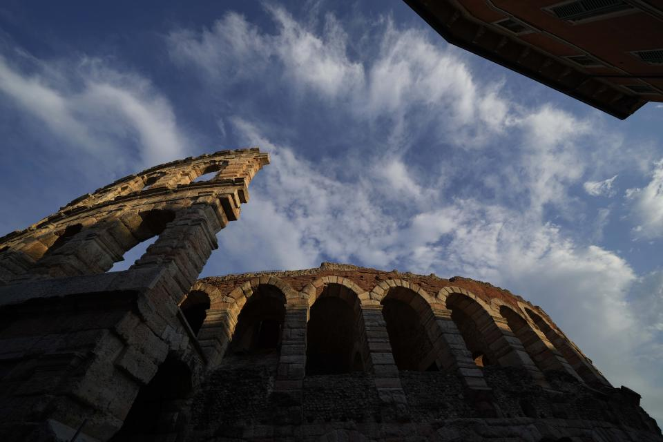 An external view of the Arena di Verona theatre, in Verona, Italy, Friday, June 25, 2021. The Verona Arena amphitheater returns to staging full operas for the first time since the pandemic struck but with one big difference. Gone are the monumental sets that project the scene to even nosebleed seats in the Roman-era amphitheater, replaced by huge LED screens with dynamic, 3D sets that are bringing new technological experiences to the opera world. (AP Photo/Luca Bruno)