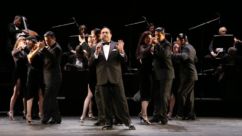 """In this July 11, 2013 photo released by The O + M Company, Gilberto Santa Rosa performs with ensemble cast of """"Forever Tango"""" at the Walter Kerr Theatre on in New York. (AP Photo/The O + M Company, Walter McBride)"""