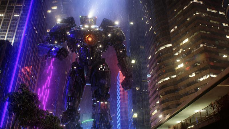 """This film publicity image released by Warner Bros. Pictures shows the Gipsy Danger robot in a scene from """"Pacific Rim."""" """"Pacific Rim"""" fulfills a very basic boyhood fantasy: big ol' robots and giant monsters slugging it out. The concept to Guillermo del Toro's """"Godzilla""""-sized film is about as simple as it gets, but actually constructing such mammoth creations is a far more arduous undertaking. (AP Photo/Warner Bros. Pictures)"""