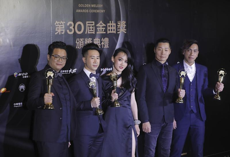 Taiwanese singers 'Chthonic' pose with their trophies after winning the Best Band at the 30th Golden Melody Awards in the Taipei on June 29, 2019. (Photo by Daniel Shih / AFP) (Photo credit should read DANIEL SHIH/AFP/Getty Images)