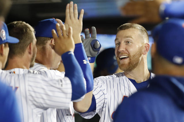 New York Mets' Todd Frazier celebrates with teammates in the dugout after hitting a solo home run, his second homer run of the night, during the third inning of a baseball game Wednesday, Sept. 11, 2019, in New York. (AP Photo/Kathy Willens)
