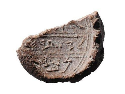 "<span class=""caption"">The remains of what has been identified as Isaiah's seal.</span> <span class=""attribution""><span class=""source"">Ouria Tadmor/ Eilat Mazar</span></span>"