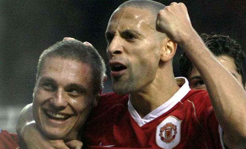 Manchester United's Nemanja Vidic (L) celebrates his goal against Portsmouth with Rio Ferdinand (R) in 2006. Reuters