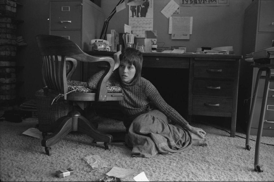 <p>Jane Fonda sits on the floor beside her desk in Hollywood in 1971.</p>