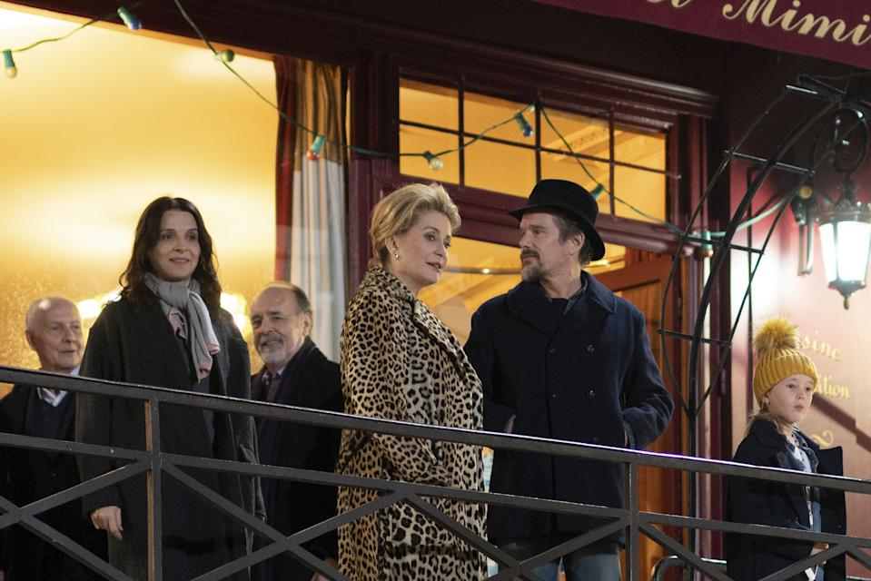 (From left, foreground) Juliette Binoche as Lumir; Catherine Deneuve as Fabienne; and Ethan Hawke as Hank in The Truth, directed by Hirokazu Kore-eda.