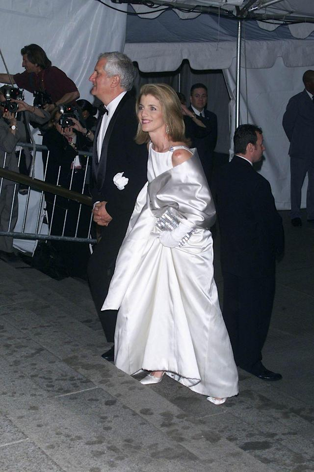 """<p>The theme of 2001's Met Gala paid homage to former First Lady <a href=""""https://www.crfashionbook.com/celebrity/g24124699/jacqueline-kennedy-onassis-secret-moments/"""" rel=""""nofollow noopener"""" target=""""_blank"""" data-ylk=""""slk:Jacqueline Kennedy Onassis"""" class=""""link rapid-noclick-resp"""">Jacqueline Kennedy Onassis</a>, named """"Jacqueline Kennedy: The White House Years<em>."""" </em>Her daughter Caroline Kennedy was a guest of honour, wearing a white satin Carolina Herrera gown that emulated the graceful style of her mother. </p>"""