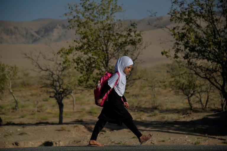 Girls have returned to some secondary schools in a northern province of Afghanistan, but they remain barred from classrooms in much of the country (AFP/Hoshang Hashimi)