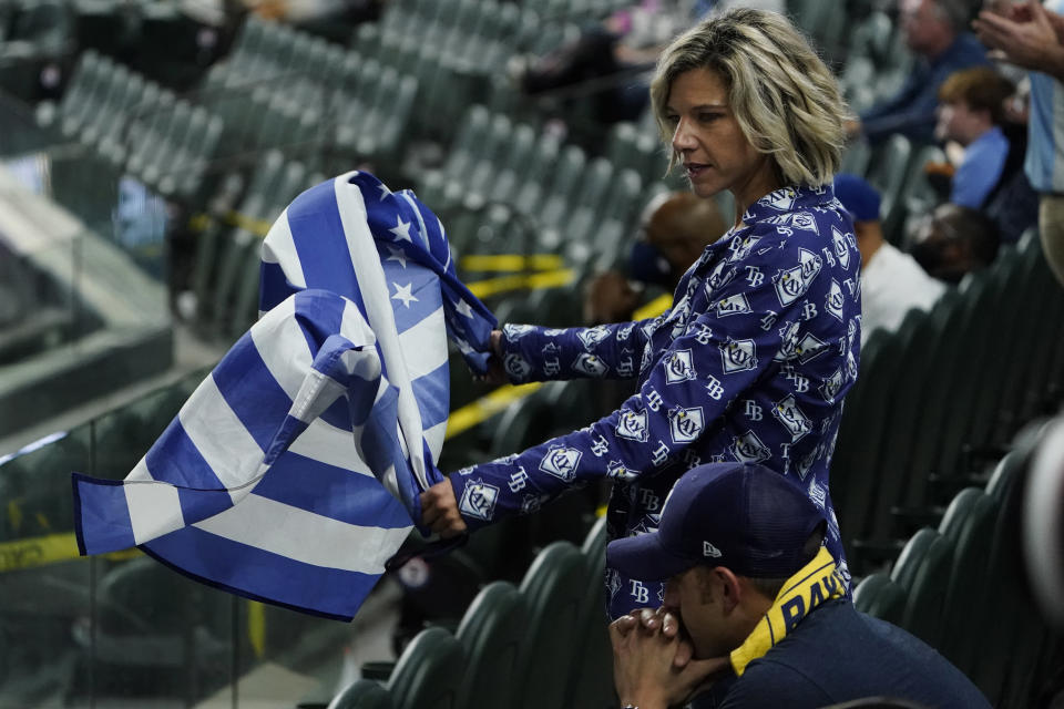 A Tampa Bay Rays fan watches during the ninth inning in Game 5 of the baseball World Series against the Los Angeles Dodgers Sunday, Oct. 25, 2020, in Arlington, Texas. (AP Photo/Tony Gutierrez)
