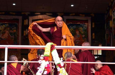 Tibetan spiritual leader the Dalai Lama arrives to deliver teachings at Yiga Choezin, in Tawang