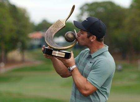 Mar 11, 2018; Palm Harbor, FL, USA; Paul Casey kisses the trophy after winning the Valspar Championship golf tournament at Innisbrook Resort - Copperhead Course. Jasen Vinlove-USA TODAY Sports