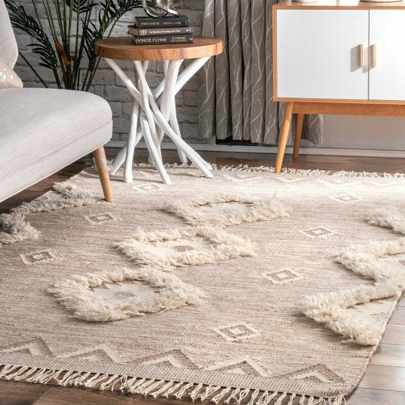 """<br><br><strong>Joss & Main</strong> Northport Geometric Hand-Knotted Wool Area Rug, $, available at <a href=""""https://go.skimresources.com/?id=30283X879131&url=https%3A%2F%2Fwww.jossandmain.com%2Frugs%2Fpdp%2Fnorthport-geometric-hand-knotted-wool-beige-area-rug-j000811803.html"""" rel=""""nofollow noopener"""" target=""""_blank"""" data-ylk=""""slk:Joss & Main"""" class=""""link rapid-noclick-resp"""">Joss & Main</a>"""