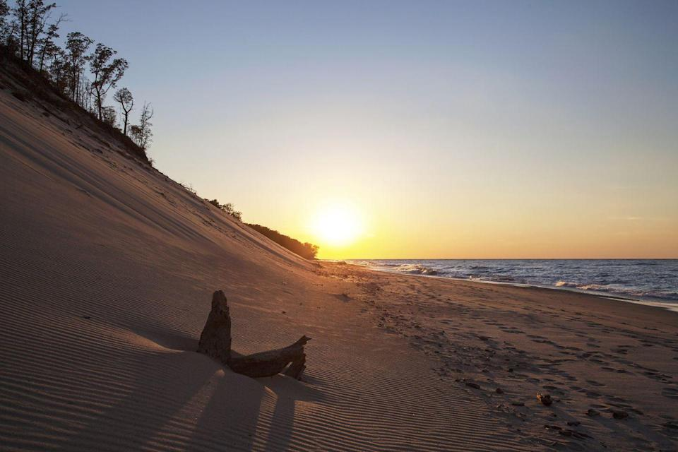 """<p>Believe it or not, Indiana is home to one of the country's most stunning beaches. With 15 miles along Lake Michigan's southern shore and 15,000 acres belonging to <a href=""""https://www.nps.gov/indu/index.htm"""" rel=""""nofollow noopener"""" target=""""_blank"""" data-ylk=""""slk:the national lakeshore area"""" class=""""link rapid-noclick-resp"""">the national lakeshore area</a>, the dunes offer visitors a variety of beautiful landscapes — dunes, wetlands, prairies, and forests included.</p>"""