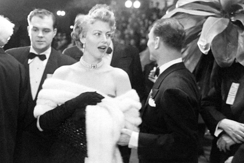 "<p>Ava Gardner was the epitome of glamour on the red carpet wrapped in a stole and <a href=""https://www.goodhousekeeping.com/life/news/a45672/princess-dianas-jewelry-kate-middleton-wears/"" rel=""nofollow noopener"" target=""_blank"" data-ylk=""slk:dripping with jewels"" class=""link rapid-noclick-resp"">dripping with jewels</a>. She presented the documentary awards. </p>"