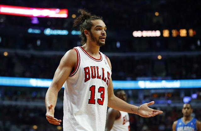 Chicago Bulls center Joakim Noah (13) reacts to being called for a foul during the first half of an NBA basketball game against the Orlando Magic in Chicago on Monday, Dec. 16, 2013. (AP Photo/Jeff Haynes)