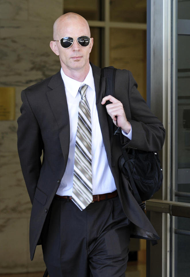 FILE - This July 14, 2011, file photo shows Jeff Novitzky leaving federal court in Washington, after a mistrial was declared in the government's perjury case against former Major League Baseball pitcher Roger Clemens. Lance Armstrong's attorneys say illegal government leaks of grand jury information have sullied the cyclist's reputation, and have asked a court to order federal agents to discuss their contacts with the media. The filing has 17 references to Novitzky, a Food and Drug Administration special agent who, in his prior job as an IRS special agent, ran the investigation into the Bay Area Laboratory Co-Operative (BALCO). (AP Photo/Cliff Owen, File)