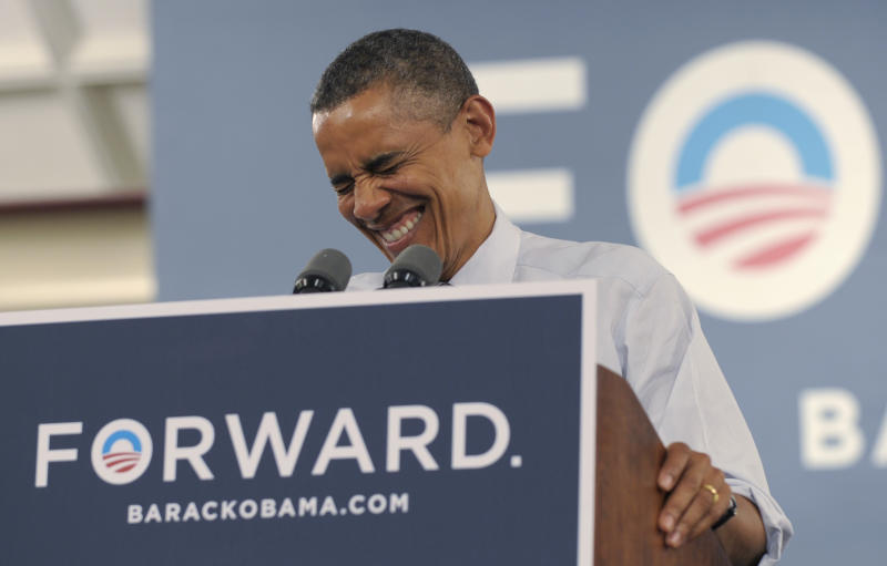 President Barack Obama shares a laugh while speaking at a campaign event at the Cincinnati Music Hall in Cincinnati, Monday, July 16, 2012. Obama is spending the day campaigning in Cincinnati. (AP Photo/Susan Walsh)