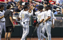 Vanderbilt's Dominic Keegan (12) celebrates with teammates as he returns to the dugout after being batted in off a single by CJ Rodriguez in the fourth inning during a baseball game against North Carolina State in the College World Series, Friday, June 25, 2021, at TD Ameritrade Park in Omaha, Neb. (AP Photo/Rebecca S. Gratz)