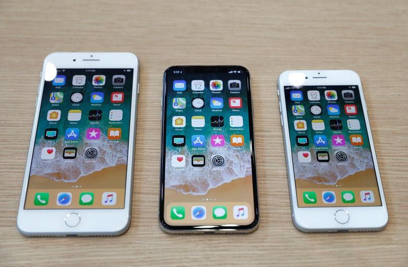 FILE PHOTO: Different iPhone 8 models are displayed during an Apple launch event in Cupertino