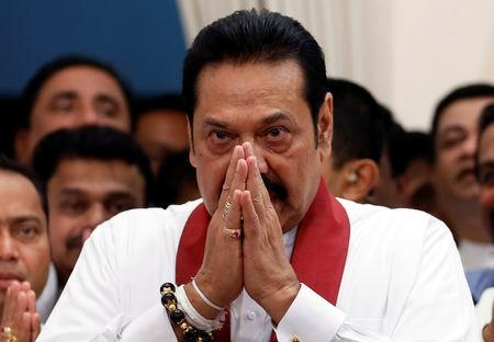 FILE PHOTO: Sri Lanka's newly appointed Prime Minister Mahinda Rajapaksa gestures during the ceremony to assume duties at the Prime Minister's office in Colombo, Sri Lanka October 29, 2018. REUTERS/Dinuka Liyanawatte/File Photo