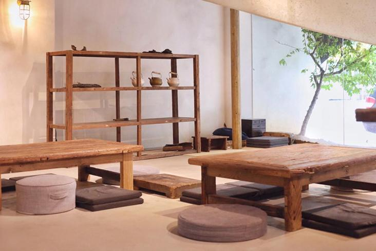 The spare, minimalist tea room invites tea drinkers to stay in the moment.