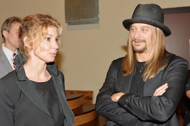 NASHVILLE, TN - MAY 02: (EXCLUSIVE COVERAGE) Country musicians Faith Hill and Kid Rock attend the funeral service for George Jones at The Grand Ole Opry on May 2, 2013 in Nashville, Tennessee. Jones passed away on April 26, 2013 at the age of 81. (Photo by Rick Diamond/Getty Images for GJ Memorial)