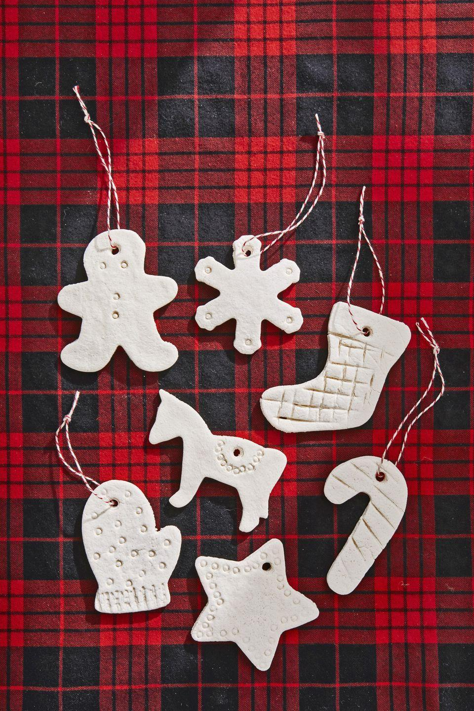 """<p><a href=""""https://www.countryliving.com/diy-crafts/g4965/salt-dough-ornament-ideas/"""" rel=""""nofollow noopener"""" target=""""_blank"""" data-ylk=""""slk:Salt dough ornaments"""" class=""""link rapid-noclick-resp"""">Salt dough ornaments</a> are a classic craft that your kids will love to make. For the perfect ones: Combine 4 cups all-purpose flour, 1 cup salt, and 1 1/2 cups of warm water in a mixing bowl. Knead until the dough is firm and smooth. Roll out dough and cut desired shapes (use a straw to poke a hole for hanging). Bake at 300°F until dry, approximately 1 hour; cool completely.</p><p><a class=""""link rapid-noclick-resp"""" href=""""https://www.amazon.com/Resinta-Christmas-Natural-Wrapping-Totally/dp/B077M9HVWK?tag=syn-yahoo-20&ascsubtag=%5Bartid%7C10050.g.1070%5Bsrc%7Cyahoo-us"""" rel=""""nofollow noopener"""" target=""""_blank"""" data-ylk=""""slk:SHOP TWINE"""">SHOP TWINE</a></p>"""