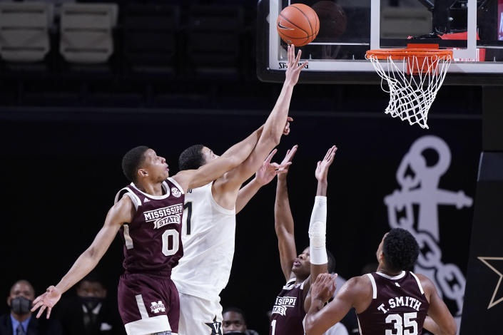 Mississippi State forward Jalen Johnson (0) tries to block a shot by Vanderbilt forward Dylan Disu (1) in the second half of an NCAA college basketball game Saturday, Jan. 9, 2021, in Nashville, Tenn. (AP Photo/Mark Humphrey)