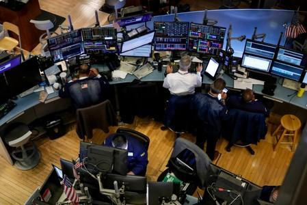 Wall St. ends flat amid rate hopes, tech declines