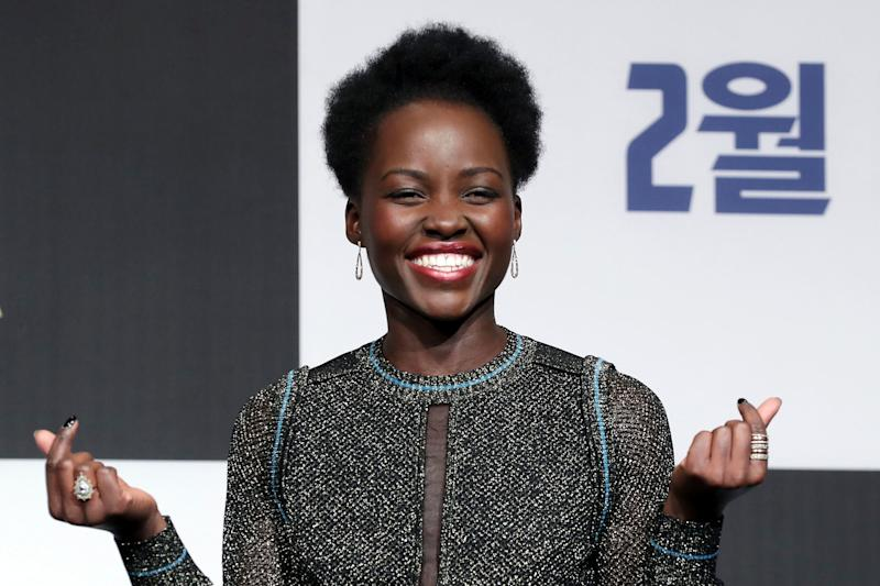 "Lupita Nyong'o pulls a double finger heart at the Seoul premiere of ""Black Panther"" earlier this month."