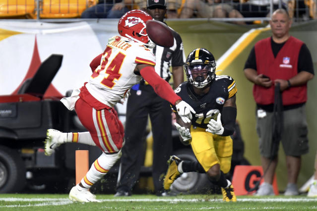 Pittsburgh Steelers wide receiver Diontae Johnson (18) looks to make a touchdown catch in front of Kansas City Chiefs cornerback Herb Miller (34) in the second half of a preseason NFL football game, Saturday, Aug. 17, 2019, in Pittsburgh. It was ruled a touchdown catch and was verified on review. (AP Photo/Barry Reeger)
