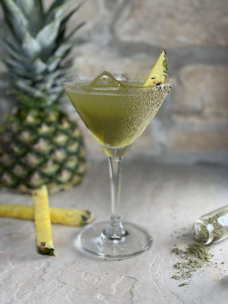 """<p>Embrace one of the traditional colors of Mardi Gras—with this smoky, sweet cocktail. The green drink, which was created by <a href=""""https://www.instagram.com/cocktails4breakfast/"""" rel=""""nofollow noopener"""" target=""""_blank"""" data-ylk=""""slk:Deena Sayers"""" class=""""link rapid-noclick-resp"""">Deena Sayers</a> for <a href=""""https://mezcaldonavega.com/home"""" rel=""""nofollow noopener"""" target=""""_blank"""" data-ylk=""""slk:Doña Vega"""" class=""""link rapid-noclick-resp"""">Doña Vega</a>, combines an equally earthy and fruity pineapple matcha juice, a peppery mezcal, and refreshing lime juice for a truly unique flavor profile.</p><p><strong>Ingredients:</strong></p><p><em>For pineapple matcha juice:</em><br></p><p>30 oz. Fresh pineapple juice<br></p><p>5 oz. Giffard banana liquor<br></p><p>5 oz. Agave syrup<br></p><p>5 tsp. Matcha powder</p><p>1/8 tsp. salt</p><p>2.5 tsp. ground cardamom</p><p><em>For cocktail: </em></p><p><em>2 oz. </em>Doña Vega Mezcal Espadin<br></p><p>2.25 oz. Pineapple matcha juice<br></p><p>.25 oz. Fresh lime juice </p><p>Mezsal Holy Hemp salt</p><p>Pineapple wedges</p><p><strong>Directions:</strong></p><p>To create the pineapple matcha juice, blend all of the ingredients, making sure all the matcha powder has dissolved. (Note: The juice will stay fresh for up to seven days.) Then, rim a rocks glass with Mezsal Holy Hemp salt and set aside. In a shaker, add all of the ingredients as well as some ice. Shake well, strain into the salted rocks glass over fresh ice, and garnish with pineapple wedges. </p>"""