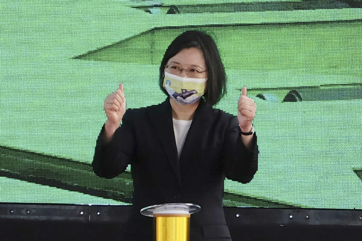 Taiwan's President Tsai Ing-wen gestures during a ceremony to inaugurate the production of domestically-made submarines at CSBC Corp's shipyards in the southern city of Kaohsiung, Taiwan on Tuesday, Nov. 24, 2020. The move marks a step forward for the island's defense strategy at a time of elevated tensions with China. (AP Photo/Huizhong Wu)