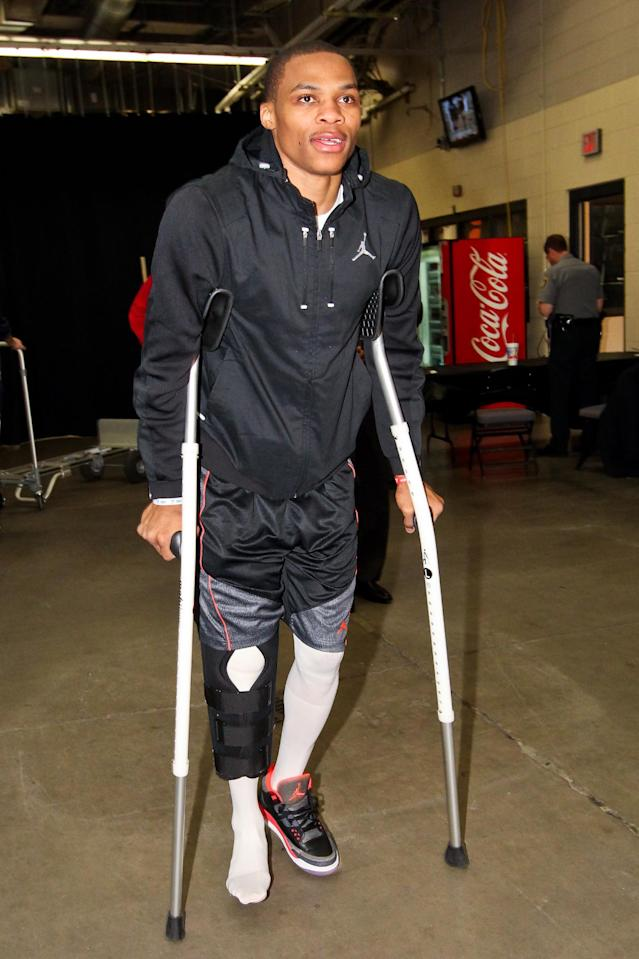 OKLAHOMA CITY, OK - MAY 5: Russell Westbrook #0 of the Oklahoma City Thunder, on crutches due to an injury, arrives before his team played the Memphis Grizzlies in Game One of the Western Conference Semifinals during the 2013 NBA Playoffs on May 5, 2013 at the Chesapeake Energy Arena in Oklahoma City, Oklahoma. (Photo by Joe Murphy/NBAE via Getty Images)